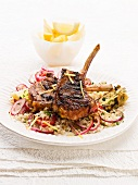 Spicy lamb chops with harissa on a bed of couscous