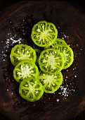 Green tomato slices with salt