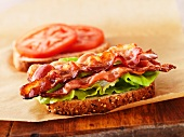 A BLT sandwich - filled with bacon, lettuce and tomato