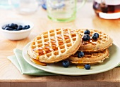 Round waffles with fresh blueberries and syrup