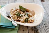 Ravioli with sage and grated cheese