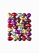 Small chocolate Easter eggs, partly wrapped in foil