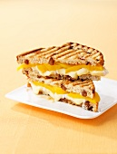 Toasted cheese sandwich with peaches and maple syrup