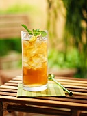 Honey and lemon drink with ice cubes
