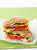 A panini filled with vegetables and cheese