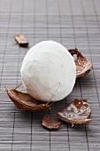 A coconut, peeled