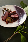 Duck breast with poached figs in red wine sauce
