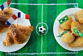Croissants (France) and salgadinhos (Brazil) with football-themed decoration
