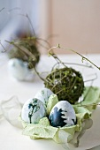 Four Easter eggs painted in natural colours