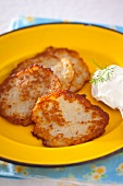 Potato fritters with a blob of sour cream