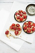 Mini sponge cakes topped with custard and strawberries