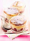 Three cherry soufflés in small glass ramekins
