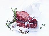 Beef fillet steak tied with kitchen string, in wrapping paper
