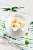 A yoghurt dessert with passion fruit sauce in an Easter porcelain bowl