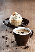 An espresso with an almond cupcake