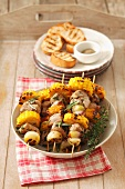 Barbecued skewers of loin pork, sweetcorn and shallots
