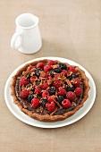 Chocolate torte with fresh raspberries and blackberries