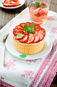 A mini cheesecake with strawberries