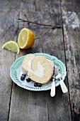 A slice of sponge roll with lemon cream filling