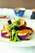 Baked aubergines with spring onions and chilli sauce