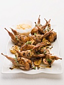 Cold roast quails with aioli and lemons