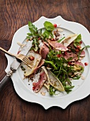 Rocket salad with smoked duck breast, chicory and pomegranate vinaigrette