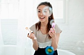 Young woman blowing bubbles with bubble wand