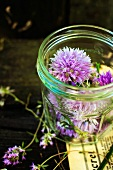 Chive flowers in a screw-top jar