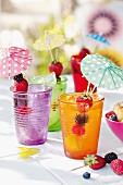 Summery drinks with cocktail umbrellas