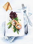 Smoked salmon and cream cheese roulade with asparagus