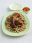 American style pork ribs in barbecue sauce with black eyed beans