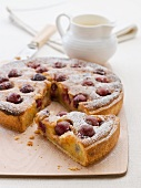 Frangipane and cherry tart with icing sugar