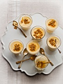 White chocolate puddings with passion fruit sauce