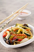 Chop Suey in a small bowl with chopsticks