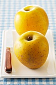 Two yellow apples