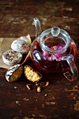 Black tea with rose petals, served with Russian biscuits