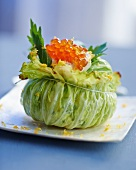 A cabbage leaf filled with smoked fish and trout caviar