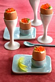 Soft-boiled eggs with caviar in eggcups