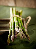 Green asparagus, bunched, on a tray