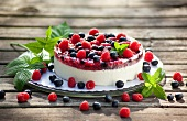 Berry layer cake with blueberries, raspberries and redcurrants
