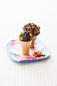 Filled ice cream cones with chocolate coating and toppings