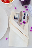 Cutlery in a folded napkin for a New Year's dinner