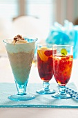 Assorted summer drinks: a chocolate milkshake, raspberry and lemon iced tea, pomegranate iced tea with lemon