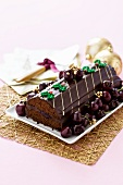 Rehrücken (cake designed to look like a saddle of venison), garnished with cherries for Christmas