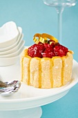 Raspberry charlotte on a cake stand