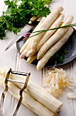 Stalks of white asparagus on a pewter plate