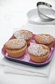 Four vanilla muffins