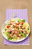 Bulgur salad with chickpeas, cherry tomatoes, onion and feta