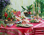 Table set with vegetable decorations: peppers, red peppers, chilies, chard, onion, etc.