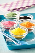 Colourful sugar in glass dishes